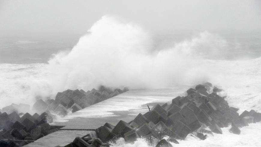 High waves batter a pier in the city of Kochi as Typhoon Vongfong blew through Shikoku on Monday afternoon.
