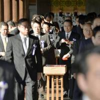 Some 110 lawmakers from five parties, including the ruling Liberal Democratic Party, visit Yasukuni Shrine in Tokyo on Friday morning as the controversial Shinto facility's autumn festival begins. | KYODO