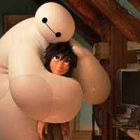 Hands on a soft body: Inflatable robot Baymax from 'Big Hero 6' gives a hug.   © 2014 DISNEY. ALL RIGHTS RESERVED.