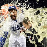 Dodgers win to even series