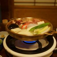 On the boil: The shirataki chicken nabe (hot pot) at Miyakagi involves quite a spread, making it ideal for sharing and great for families. | ADAM MILLER
