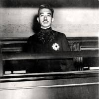 In the spotlight: Emperor Hirohito peers from a window of a railway car in Tokyo as he travels to his family shrine on Nov. 11, 1945.   AP