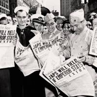 The end is near: Servicemen in New York read newspaper extras saying Japan is ready to accept unconditional surrender if Emperor Hirohito can retain his prerogatives on Aug. 10, 1945. | AP