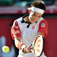 Guts lead to glory: Kei Nishikori reached a career-high ranking of sixth in the world this week following his second straight tournament victory in Tokyo on Sunday. | AFP-JIJI