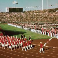 Memorable moment: The Japan delegation marches around the track at Tokyo's National Stadium during the Opening Ceremony of the Olympic Games on Oct. 10, 1964. | KYODO