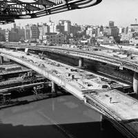 Price of progress: Massive construction projects in Tokyo, like the expressway seen here in this Dec. 16, 1963, photo, helped modernize the city, but exacted a toll on the environment. | AP