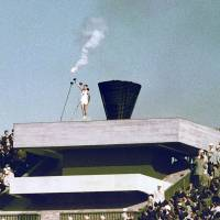Blast from the past: Yoshinori Sakai, the final relay torchbearer in the first Tokyo Olympics, lights the caldron at the National Stadium on Oct. 10, 1964. The caldron was removed Friday and will be displayed in tsunami-hit Ishinomaki before returning to the rebuilt stadium ahead of the 2020 Summer Olympics.  | KYODO