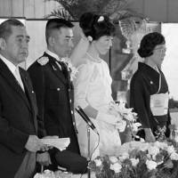 Source of pride: Tokyo Olympic volleyball gold medalist Masae Kasai's wedding in May 1965 attracted national attention, and Prime Minister Eisaku Sato (left) and his wife were on hand for the ceremony. | KYODO