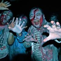 Convincing-looking zombies maul drinkers at the Zombie Bar. | KIT NAGAMURA