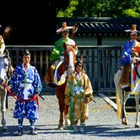 Horsing around: Assistants dressed in period costume stand beside samurai archers. | ANGELES MARIN CABELLO
