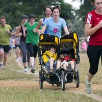 Run for your life: Joggers participate in a parkrun at southwestern London's Bushy Park in August. | REUTERS