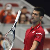 Djokovic remains perfect in Beijing
