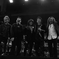From left, Starship vocalist Mickey Thomas, former Toto frontman Bobby Kimball, former Deep Purple vocalist Joe Lynn Turner, Tokyo Art Foundation Chairman Haruhisa Handa and former Journey singer Steve Augeri pose at the end of their concert at Tokyo's Nippon Budokan on Sept. 26. | TOKYO ART FOUNDATION