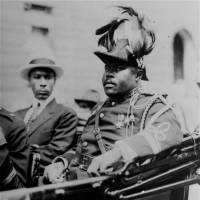 Black nationalist leader Marcus Garvey attends a parade to mark the 1922 Convention of the Negro Peoples in Harlem, New York. | AP