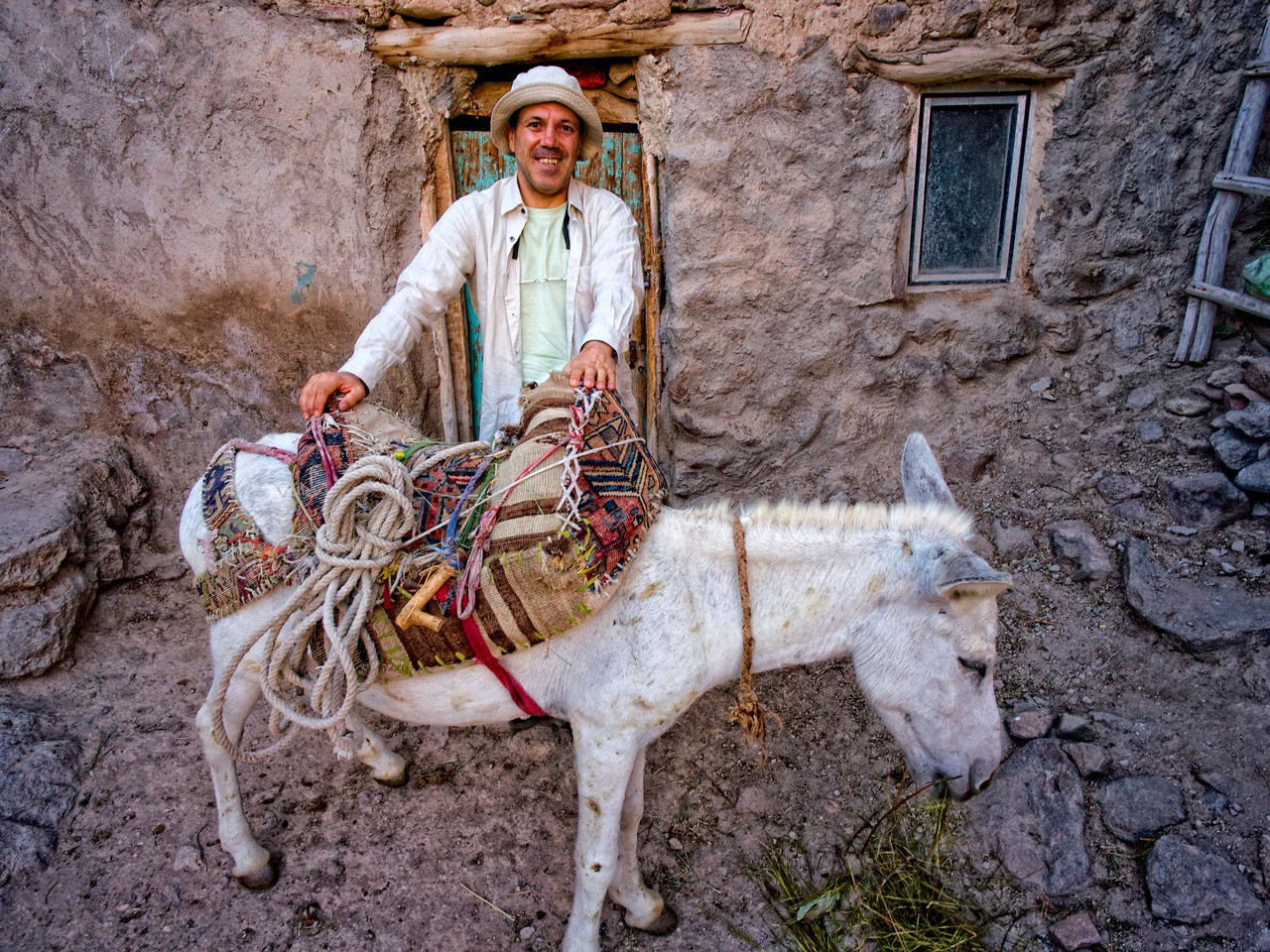 Off the beaten track: Manuel Bruges stands beside his mode of transport while on assignment in Iran. | COURTESY OF MANUEL BRUGES