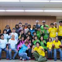 Hands on deck: Danny Gong (front) and DeafJapan supporters meet members of the deaf community in tsunami-hit Ishinomaki, Miyagi Prefecture, in 2012. | DEAFJAPAN