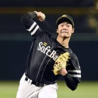 Cool customer: Shota Takeda shut out the roar of the Koshien Stadium crowd to lead the Fukuoka Softbank Hawks to victory in Game 2 of the Japan Series on Sunday night. | KYODO