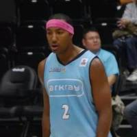 Popular figure: Kyoto Hannaryz power forward Reggie Warren wore a pink headband for the first time during last Saturday's game, showing support to those battling cancer. | PHOTO COURTESY OF REGGIE WARREN