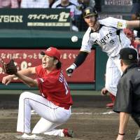 Undefeated: The Hanshin Tigers and Hiroshima Carp dueled for 12 scoreless innings in their Climax Series game on Sunday, but it was the Tigers who advanced to the next stage thanks to playoff rules. | KYODO