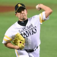 Bird of prey: Fukuoka Softbank starting pitcher Kenji Otonari delivers during the Hawks' 5-1 win over the Tigers in Game 3 of the Japan Series at Yafuoku Dome on Tuesday. | KYODO