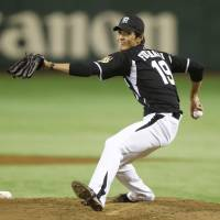 Get even: Hanshin starting pitcher Shintaro Fujinami delivers against the Giants at Tokyo Dome on Wednesday night. | KYODO