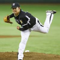 Steady lefty: Tigers southpaw Minoru Iwata held the Giants to two runs in seven innings on Thursday.   KYODO