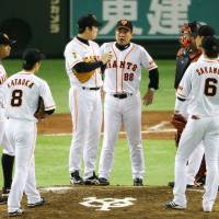 Not their night: Giants manager Tatsunori Hara (88) tries to guide his players to victory in Game 3. | KYODO