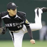 Another day on the job: Tigers starter Atsushi Nomi pitched five innings in the series finale. | KYODO