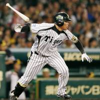 Key at-bat: The Tigers' Kosuke Fukudome hits an RBI double in the fifth inning in Game 1. | KYODO