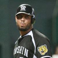 An uphill climb: Mauro Gomez and his Hanshin Tigers teammates trail the Fukuoka Hawks 3-1 in the best-of-seven Japan Series. | KYODO