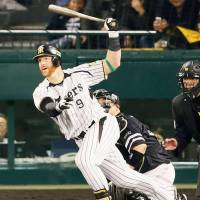 Skilled batsman: The Tigers' Matt Murton strokes a two-run double in the fifth inning. | KYODO