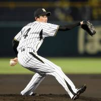 On the job: Tigers starter Atsushi Nomi throws a pitch during Game 2 of the Japan Series on Sunday. | KYODO