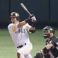 Delivering in the clutch: The Hawks' Nobuhiro Matsuda drives in the game's only run in the eighth inning on Thursday at Yafuoku Dome. | KYODO