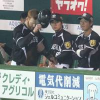 Frustration: The Hanshin Tigers were held to five hits in their final loss of the season. | KYODO