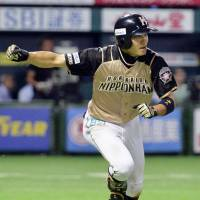 Flip the script: Hokkaido Nippon Ham's Takuya Nakashima rounds the bases after hitting a two-run single in the top of the 11th inning of Sunday's game at Yafuoku Dome. | KYODO