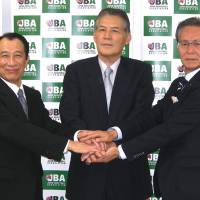Issues to resolve: (From left) NBL chief operating officer Mitsuru Maruo, Japan Basketball Association chairman Yasuhiko Fukatsu and bj-league commissioner Toshimitsu Kawachi are seen in this file photo from July. The three men are key figures in merger talks between the NBL and bj-league. | KAZ NAGATSUKA