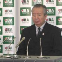 Still unresolved: Japan Basketball Association acting president Mitsuru Maruo (left) and Yoshiki Hoshi, the JBA secretary general, attend a news conference on Wednesday in Tokyo. The JBA has not finalized a plan for a merger between the NBL and the bj-league despite a FIBA-issued deadline of Oct. 31. | KAZ NAGATSUKA