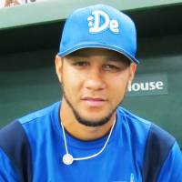 Keeping positive: Yokohama BayStars infielder Yulieski Gourriel gives a 'thumbs-up' sign prior to a late-season game against the Yomiuri Giants at Tokyo Dome, despite the uncertainty of his future — and that of his countrymen — in Japan. | WAYNE GRACZYK