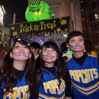 Shibuya was Halloween central in Tokyo Friday night as thousands of people in costumes gathered and posed for the cameras. | AFP-JIJI