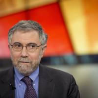 How economist Krugman's meeting with Abe may have swung decision to postpone tax hike