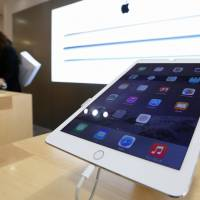 Apple Inc.'s new iPad Air 2 is displayed at a SoftBank store in Tokyo's Ginza district last month.   BLOOMBERG