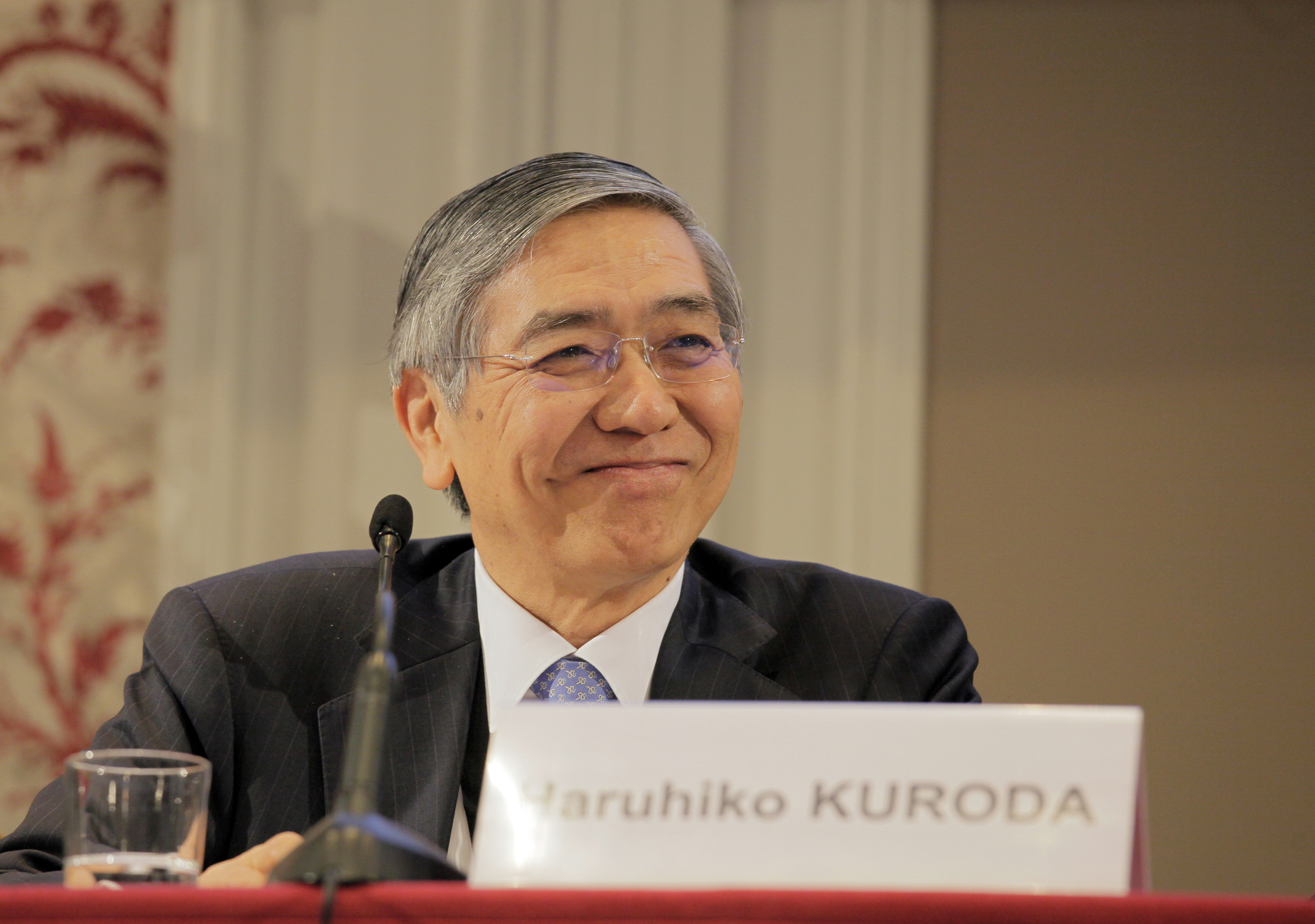 Bank of Japan Gov. Haruhiko Kuroda attends the International Symposium of the Bank of France policy conference in Paris on Friday. | BLOOMBERG
