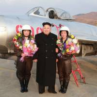 North Korean leader Kim Jong Un poses with pilots from the Korean People's Army Air Force at an undisclosed location in North Korea in an undated photo released by the official Korean Central News Agency. Sony Corp.'s film and TV studio said several films may have been stolen in a Tuesday cyberattack that may be linked to North Korea. | AFP-JIJI