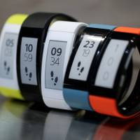 Sony Corp.'s SmartBand Talk devices are displayed at its Tokyo showroom in September. The manufacturer is reportedly preparing a watch made of electronic paper. | BLOOMBERG