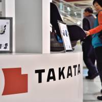 Takata Corp. products are displayed in an auto showroom in Tokyo on Tuesday. | AFP-JIJI