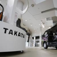 Child seats manufactured by Takata Corp. are displayed at a Toyota Motor Corp. showroom in Tokyo on Thursday. The firm, which also makes air bags, is embroiled in a massive recall totaling some 12 million vehicles globally. | AP