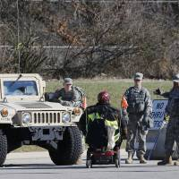 Missouri governor orders more National Guard troops after Ferguson erupts
