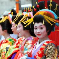 Women dressed as 'oiran,' high-class prostitutes and courtesans from the Edo Period, line up during the Oiran Dochu parade in Tokyo's Shinagawa Ward on Sept. 27. | YOSHIAKI MIURA