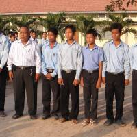 Kong Vorn (second from left) poses with students at the Cambodia-Japan Friendship Middle and High School in Prey Veng Province, about 90 km outside Phnom Penh, in this photo taken in 2010. | KYODO