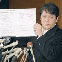 Mamoru Samuragochi, a composer once touted as a modern-day Beethoven but now accused of faking his deafness, holds a news conference in March in Tokyo. | KYODO